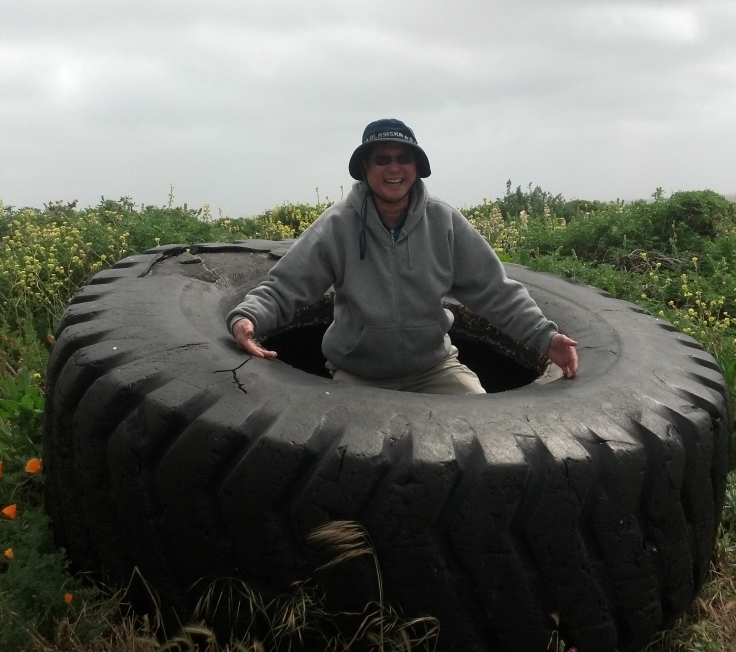 Dad in the big ass tire (cropped)