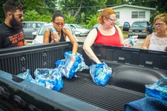 Water provided from local support for marchers.